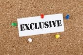 picture of exclusive  - Exclusive note paper pinned on cork bulletin board - JPG