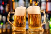 picture of jug  - Jugs of beer placed on bar counter with copy space - JPG