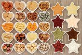 image of crisps  - Crisp and dip party food selection in heart and star shaped porcelain bowls over bamboo background - JPG