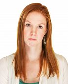 stock photo of sulky  - Isolated pouting red haired Caucasian female over white - JPG
