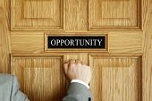 Businessman knocking on a door to Opportunity office concept for aspirations, progress meeting or  poster