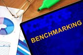 pic of benchmarking  - Tablet with Benchmarking and charts on a wooden board - JPG