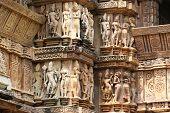 stock photo of khajuraho  - Khajuraho temples and their erotic sculptures - JPG