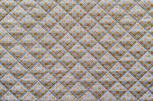 pic of quilt  - grained texture quilted fabric of lilac color with an abstract brown pattern from crosses - JPG