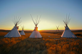 pic of tipi  - Group of North American Plains Indian style tipis at sunrise on the prairie - JPG