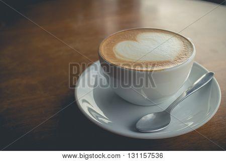 hot coffee with foam milk art of love. White cup of coffee. Coffee cup. Cup of coffee. Coffee break.(vintage effect)