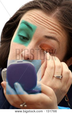 Picture or Photo of Applying makeup in shapes on the face