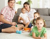 stock photo of nuclear family  - Little girl  - JPG