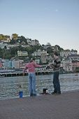 pic of dartmouth  - teenage boy and girl fishing for crabs in dartmouth england  - JPG