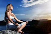 stock photo of breathing exercise  - Slender young woman doing yoga exercise outdoors - JPG