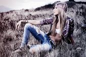 stock photo of hippy  - Beautiful young woman hippie posing over picturesque landscape - JPG