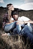 pic of hippy  - Beautiful young couple hippie posing together over picturesque landscape - JPG