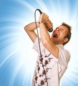 Young guy with a microphone over abstract background