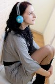 Caucasian Dark Haired Woman With Earphones