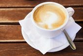 stock photo of coffee-cup  - Coffee cup on wooden table - JPG