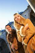Attractive couple in lambskin coats