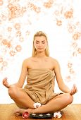 Beautiful young woman meditating