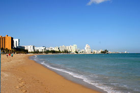 image of san juan puerto rico  - beach scene in puerto rico with hotels in the background