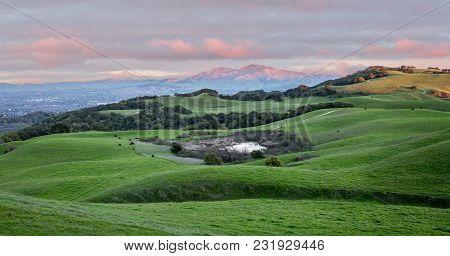 Sunset Over Rolling Grassy Hills