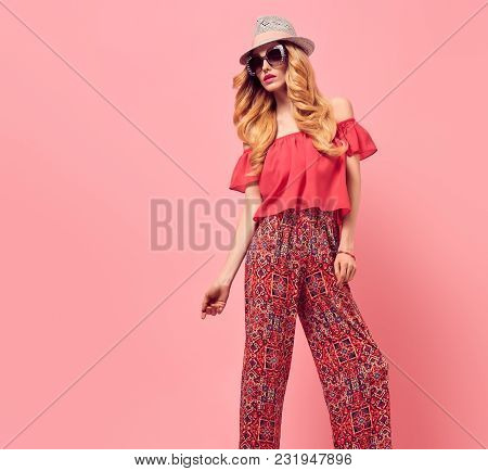 poster of Fashion Young Woman In Summer Stylish Outfit. Wavy Hair, Trendy Pants, Luxury Sunglasses, Fashion Ha