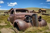 Car Wreck In Bodie Ghost Town, California. Bodie Is A Historic State Park From A Gold Rush Era  In T poster