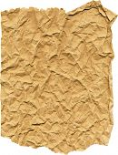 ripped brown paper crumpled up on a white background with clipping path