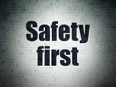 Safety Concept: Painted Black Word Safety First On Digital Data Paper Background poster