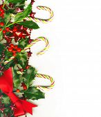 Christmas border with candy canes isolated on white background