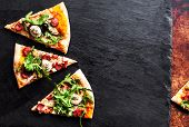Meat  Pizza With Sausage,  Mozzarella Cheese And Tomato On Black Stone Background With Copy Space. P poster