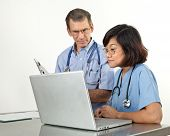 Doctor And Nurse at Laptop Computer