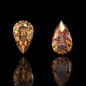 Pear. Citrine. Collections of jewelry gems on black