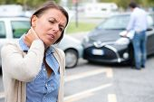 Woman Feeling Pain After Car Accident In The City poster