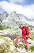 woman backpacker at Five Spis Tarns, Vysoke Tatry (High Tatras), Slovakia