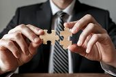 Businessman Hand Connecting Jigsaw Puzzle.business Solutions, Success And Strategy Concept. poster