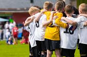 Children Soccer Team. Kids Football Academy. Young Soccer Players In Jersey Shirts Standing Together poster