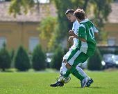 KAPOSVAR, HUNGARY - SEPTEMBER 5: Gerely Jozsef (in green) in action at the Hungarian National Championship under 19 game Kaposvar (white) vs. Nagyatad (green) September 5, 2011 in Kaposvar, Hungary.