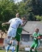 KAPOSVAR, HUNGARY - SEPTEMBER 5: Daniel Vaszilko (in white) in action at the Hungarian National Championship under 19 game Kaposvar (white) vs. Nagyatad (green) September 5, 2011 in Kaposvar, Hungary.