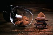 Assortment Of Dark And Milk Chocolate Stack, Truffles. Sweets In A Glass. Chocolate With Cocoa Powde poster