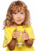 Child with a glass of water isolated on white