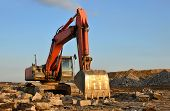 Large Tracked Excavator Works In A Gravel Pit. Salvaging And Recycling Building And Construction Mat poster