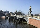 Amsterdam. Famous Blue Bridge Over The River Amstel