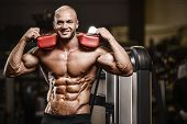 Handsome Strong Athletic Man Pumping Up Muscles Workout Fitness And Bodybuilding Concept Background poster