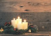 Fourth Advent Candle, Christmas Background With Four Advent Candles On A Rustic Wooden Wall poster