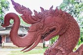 Dragon, Scorpionfish, Wat Sila Ngu With The Red Temple Wat Ratchathammaram On Koh Samui In Thailand. poster