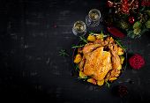 Baked Turkey Or Chicken. The Christmas Table Is Served With A Turkey, Decorated With Bright Tinsel.  poster