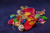 Red Wool Present Socks And Different Colors Gifts With Bows And Ribbons Are On The Blue Silk Velvet  poster