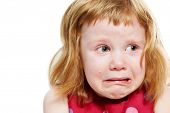 image of scared baby  - Scared crying little girl with tears on her cheeks - JPG