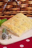 stock photo of nic  - Typical italian focaccia bread with oregano and rosemary - JPG