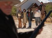 image of gunfights  - Six old west gunfighters target a man in black - JPG