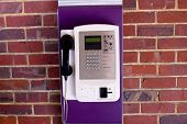 Phone On Brick Wall